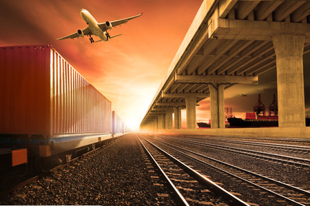 industry container trains running on railways track  cargo plane flying with land bridge transportation over ship port use for land ,air and ship transportation in logistic business industry ,import expoert shipping service