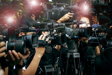 Photo pour press and media camera ,video photographer on duty in public news coverage event for reporter and mass media communication - image libre de droit