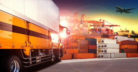 container truck in shipping port ,container dock and freight cargo plane flying above use for transportation and logistic indutry