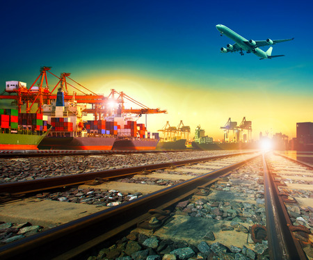 Photo pour railway transport in import export shipping port and cargo plane logistic flying above use as freight and transportation business service - image libre de droit