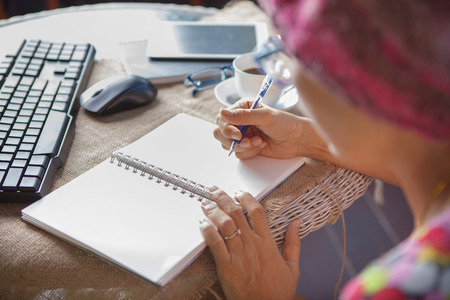 Photo pour woman writing shot memories note on white paper with relaxing time and emotion - image libre de droit