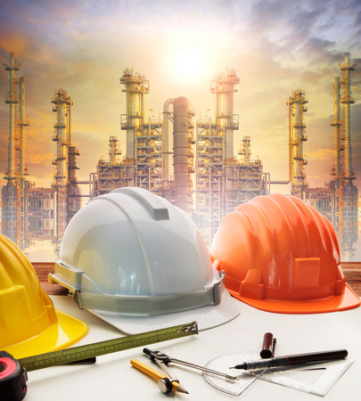 Photo for engineer working table plan, and oil refinery plant in heavy petrochemical industry - Royalty Free Image