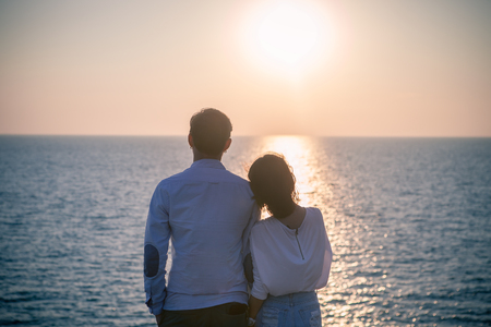 Photo for hipster photography style of younger love couples vacation relaxing with sun set sky at destination sea side happiness emotion - Royalty Free Image