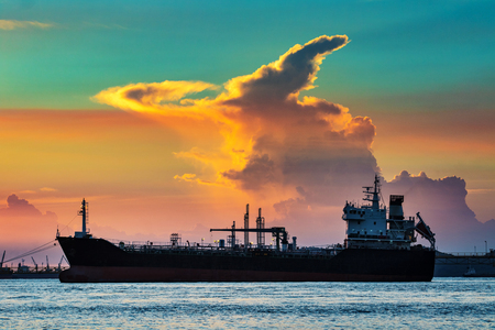 Photo for oil container ship floating in petrochemical industry port against beautiful sunset sky - Royalty Free Image