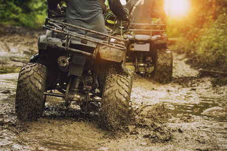 Photo pour man riding atv vehicle on off road track ,people outdoor sport activitiies theme - image libre de droit