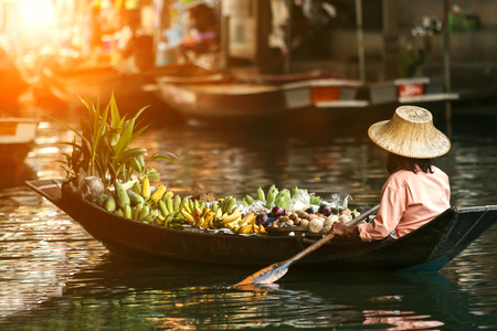 Photo for fruit seller in wooden boat - Royalty Free Image