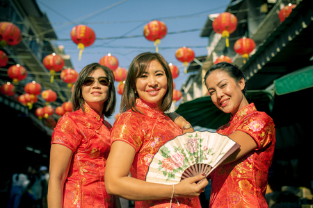 Foto de three asian woman wearing chinese tradition clothes toothy smiling face in yaowarat street china bangkok thailand - Imagen libre de derechos