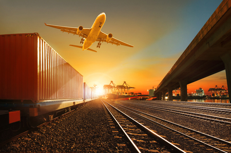 Photo pour cargo plane flying over container trains and commercial shipyard background - image libre de droit