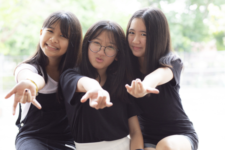 Photo pour cheerful of three asian teenager happiness emotion - image libre de droit