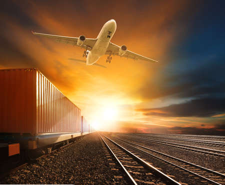 logistic  trains and cargo plane flying against beautiful sky background