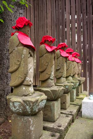 Tokyo, Japan-October 5, 2018: Buddhist guardian deity of children and travelers, or Bodhisattva Jizo, or statue of the Budd Hist deity called Jizo or Ojizo