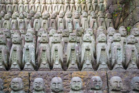 Little Buddha statues praying at the Hase-Dera temple in Kamakura, Japan