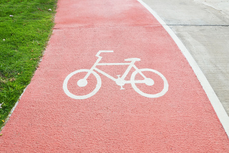 Photo for close up bicycle symbol on red street, bicycle path - Royalty Free Image