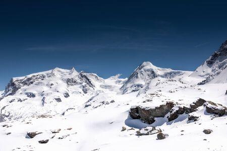Photo pour Beautiful Natural Landscape Scenery View of Mountains Swiss Alps at Zermatt, Switzerland. Nature Scenic Outdoors of Europe Mountains Alpine Against Blue Sky Background, Travel Destination - image libre de droit