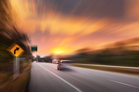 Photo for Motion Movement of Vehicle Car in Transportation Mode on Traffic Road, Motions Blur of Automotive While Speed Moving on Motorway During Sunset Scene. Transport Car Driving and Safety concept - Royalty Free Image