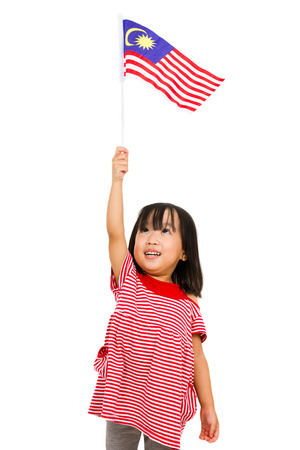 Asian chinese child with Malaysia Flag in isolated white background.