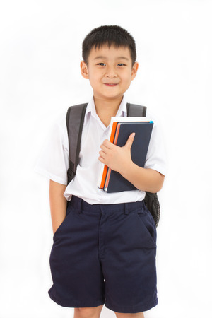 Photo for Asian Little School Boy Holding Books with Backpack on White Background - Royalty Free Image