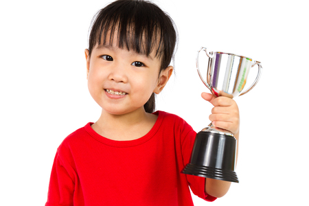 Photo pour Asian Little Chinese Girl Smiles with a Trophy in Her Hands Isolated on White Background. - image libre de droit
