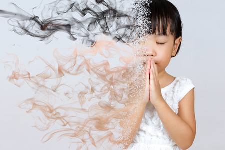 Asian Little Chinese Girl Praying in isolated White Background