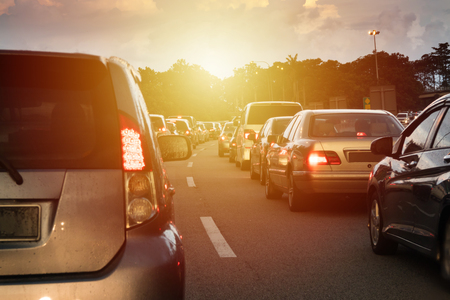 Foto de Sunset traffic jam in the middle of Malaysia North South Highway. - Imagen libre de derechos