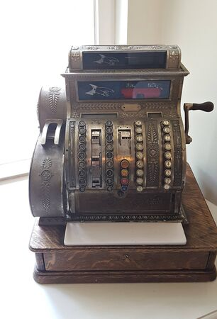 Photo pour Very old antique cash register for the interior in the Malpils Manor room. Latvia, May 2019. - image libre de droit