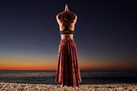 Foto de Woman meditating at morning time - Fitness exercise concept for healthy lifestyle and positive mind - Main focus on the human silhouette - Imagen libre de derechos