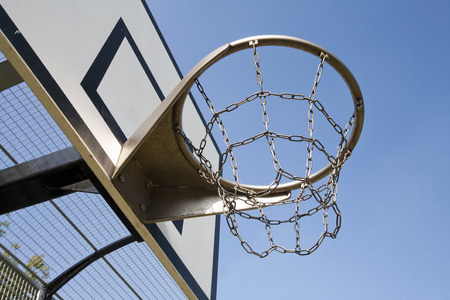 Heavy duty basketball hoop with metal net in a basketball cage