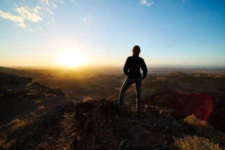 Photo for Woman at Wadi Rum sunset - Royalty Free Image