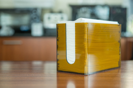 Orange box with napkin in coffee shop