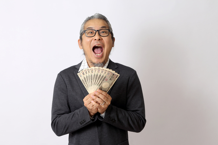 Photo pour The Asian man holding money on the white background. - image libre de droit