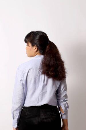 Photo pour The Asian woman posing on the white background. - image libre de droit