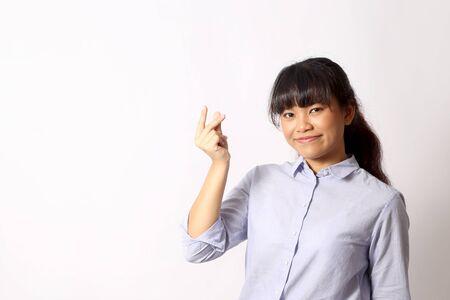 Foto de The Asian woman posing on the white background. - Imagen libre de derechos