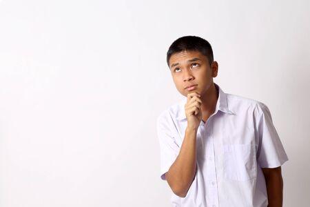Foto de The young Thai student boy on the white background. - Imagen libre de derechos
