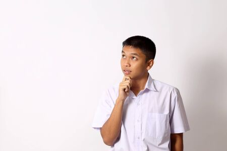 Photo pour The young Thai student boy on the white background. - image libre de droit