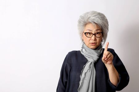 Foto per The elder Asian woman on the white background. - Immagine Royalty Free