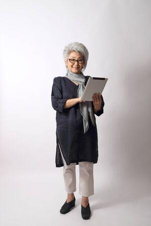 Foto de The elder Asian woman on the white background. - Imagen libre de derechos