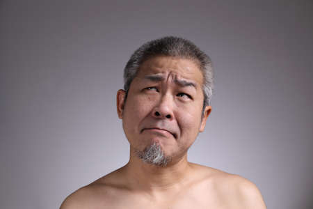 Photo for The Portrait of Asian man on the grey background. - Royalty Free Image