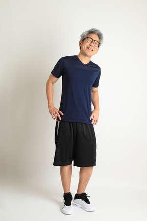 Foto für The Asian senior man with sport clothes on the white background. - Lizenzfreies Bild