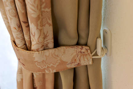Photo pour a curtain fastened to the wall hook - image libre de droit