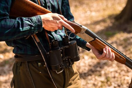 Photo for Close-up of a man holding weapons in the woods. - Royalty Free Image