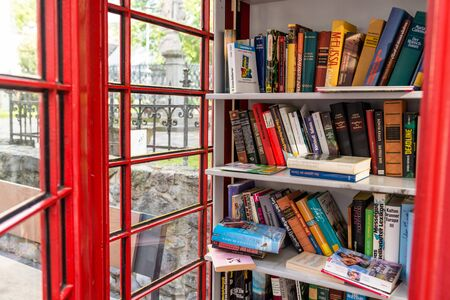 Konigswinter, Germany - 23 May 2019. A red telephone booth for the free exchange of books.
