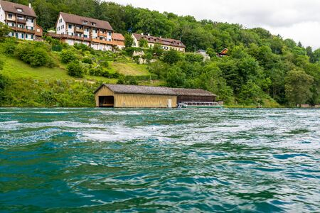Photo for Beautiful view of the Rhine river in turquoise, at the source in Switzerland, just behind the biggest waterfall in Europe. - Royalty Free Image