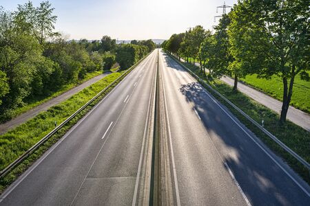 Photo pour An empty expressway in Germany in the middle of the day due to the COVID-19 coronavirus pandemic. - image libre de droit