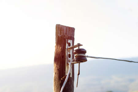 Photo for Electric poles made of wood do not look as strong or as safe as they should be - Royalty Free Image