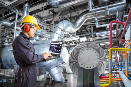 Photo pour Engineer using laptop computer for maintenance in thermal power plant industrail - image libre de droit