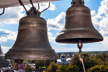 Foto für Ancient church bells. Old church and blue sky with clouds in the background - Lizenzfreies Bild
