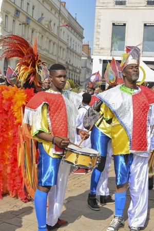 LE MANS, FRANCE - APRIL 22, 2017: Festival Evropa jazz men in colorful costumes play drums in the street