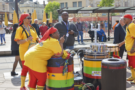 LE MANS, FRANCE - APRIL 22, 2017: Festival Europe jazz Musicians playing drums and dancers dance Caribbean dance