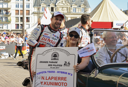 LE MANS, FRANCE - JUNE 16, 2017:Team of Toyota Racing Toyota TS050, drivers Y.Kunimoto - M. Lopez - N. Lapierre at a parade of pilots racing 24 hours