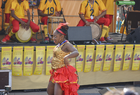 LE MANS, FRANCE - APRIL 22, 2017: Festival Evropa jazz Musicians playing drums and dancers dance Caribbean dance in costumes